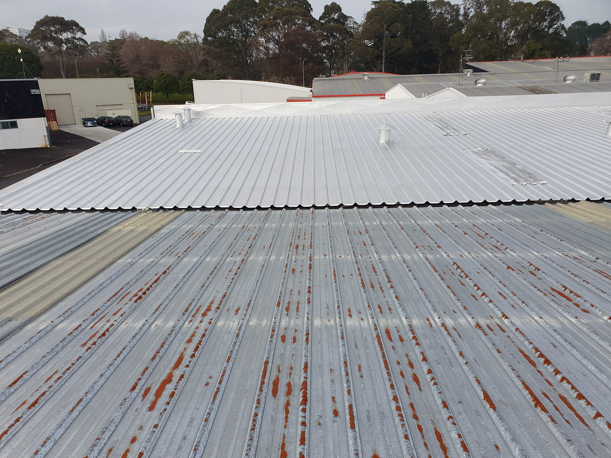 Rusty commercial roof from neighbour - Home