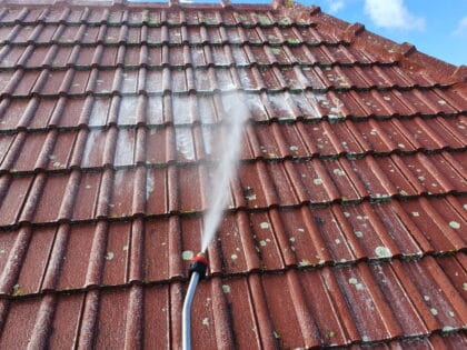 Moss and lichen treatment applied to concrete tile roof